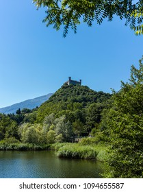 Lake Pistono (Piedmont, Italy), with the castle of Montalto Dora (12th century) on the top of the hill.