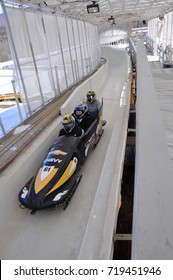 LAKE PLACID, NY, USA - MAR. 20, 2011: Bobsled at Mt. Van Hoevenberg Olympic Bobsled Run of Olympic Sports Complex. Lake Placid hosted 1932 and 1980 Winter Olympic Games, Adirondack Mountains.