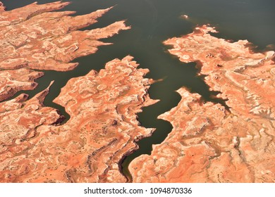 Lake Powell area, on the border of Arizona/Utah offers spectacular views and incredible natural formations. Numerous tiny cars, caravans, RVs, boats and people. Aerial image.