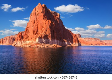 Lake Powell is surrounded by magnificent sandstone hills. Scenic huge artificial water basin of the Colorado River, USA. Walk on the boat at sunset