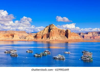 Lake Powell, UT USA - October 25, 2016: The beauty of Lake Powell in Utah with houseboats and canyons in the background.