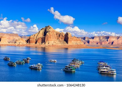 Lake Powell, Utah USA - October 25, 2016: The beauty of Lake Powell in Utah with houseboats and canyons in the background.