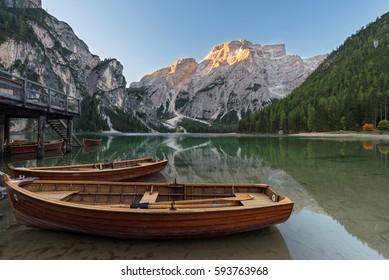 Lake Pragser Wildsee (Lago di Braies) with Mount Seekofel and boats, Fanes-Sennes-Braies national park, Dolomites, South Tyrol, Italy