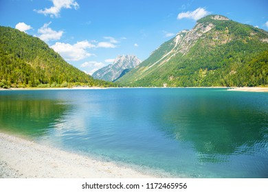 Lake Predil with turquoise water and mountains in background near Tarvisio in European Alps in Italy