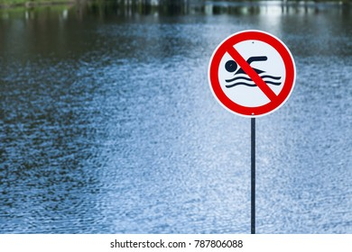 Lake with prohibited sign swimming.