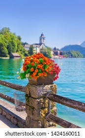 "Lake promenade with flower arrangements, at the ""Wolfgangsee"" in Austria."