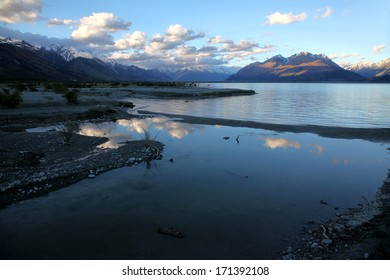 Lake Pukaki in the foreground reflecting the evening sky, with the Mountains of the Cook range in the background