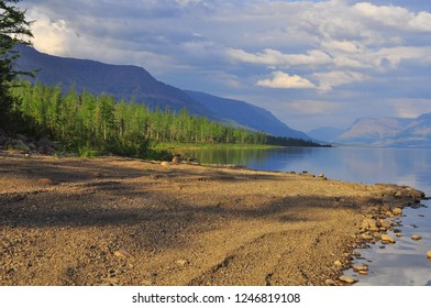 Lake in the Putorana plateau in the summer. Landscape of a mountain lake under a cloudy sky.