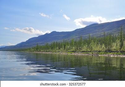 Lake in the Putorana plateau. Water mountain landscape in Siberia, Russia.