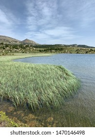 Lake in the Pyrenees landscape during the summer season in France
