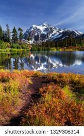 Lake reflecting Mount Shuksan on a beautiful day in Washington State