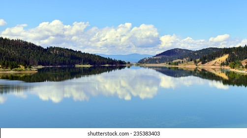 lake and reflection of clouds in Montana near Glacier National Park in Summer