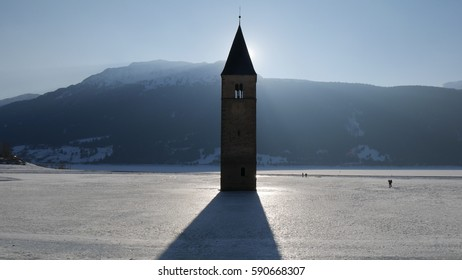 The lake of  Resia is an artificial reservoir in the west of South Tyrol, to be precise at Curon in Val Venosta, Italy. Its striking landmark is a a steeple towering from the lake.