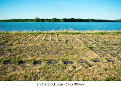 Lake or river, blue cloudless sky, grassy track, landscape
