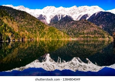 Lake Riza. Abkhazia. Nature Background Summer. Sea horizon. Mountains Of Abkhazia. Black sea. Summer holiday.beautiful and wonderful Snow Mountain winter view. Abkhazia