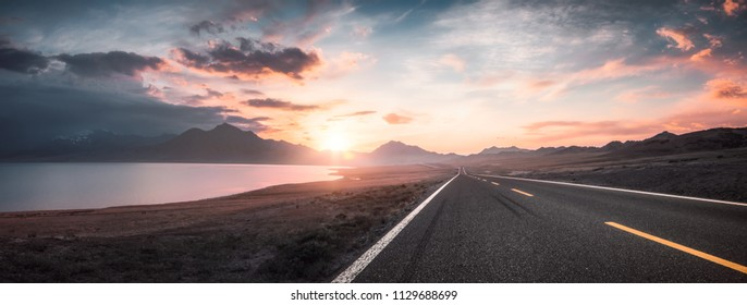 Lake and road  at sunset