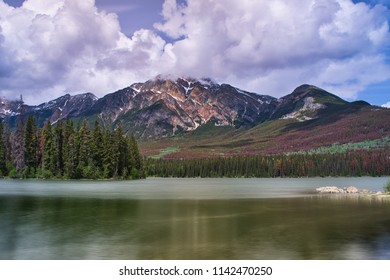 Lake in the Rocky Mountain. Perfect scenery. Reflection and beautiful clouds.