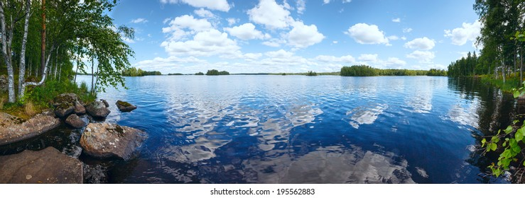 Lake Rutajarvi summer view with reflection of clouds on water surface (Urjala, Finland).