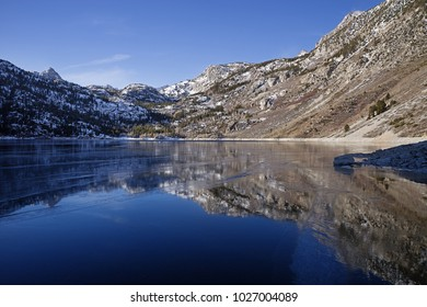 Lake Sabrina in the Sierra Nevada frozen with reflective ice