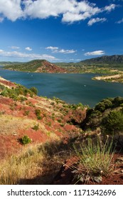 Lake Salagou, surrounded by red coloured Permian deposits, so called 'ruffes', clay-like sediments rich in iron oxide