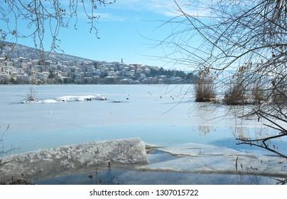 Lake scenery with frozen Orestiada lake and Kastoria town as background