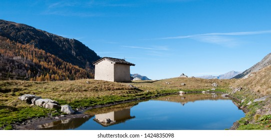 Lake and small house in Tarentaise, near Bourg Saint Maurice
