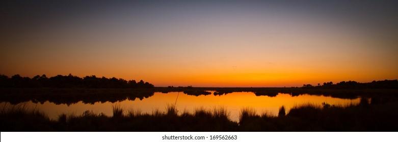 Lake at sunset, Black Point Wildlife Drive, Merritt Island National Wildlife Refuge, Titusville, Florida, USA