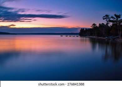 Lake Superior Dawn. Sunrise reflections along the shores of a calm Lake Superior.