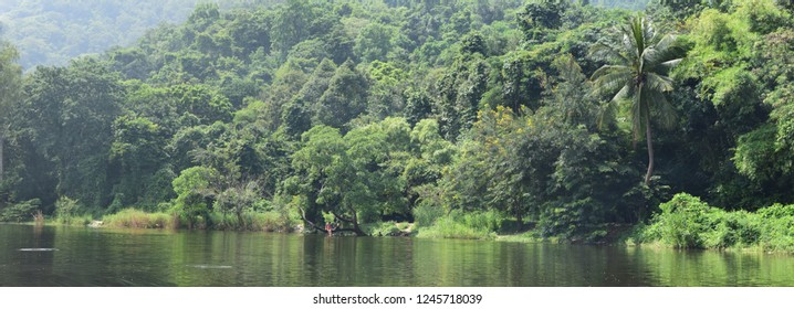 A lake surrounded by mountains. Filled with nature. green.