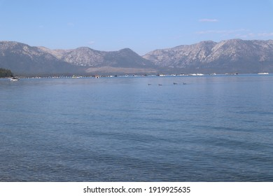 the lake Tahoe with boats and mountains in the background in Sout Tahoe, California - Shutterstock ID 1919925635