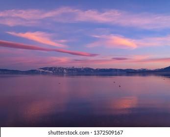 LAKE TAHOE, CALIFORNIA, USA - JANUARY 15, 2011: Sunset and reflections on lake.