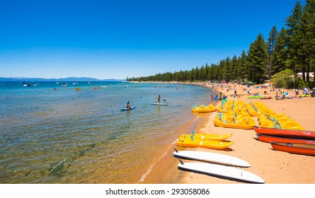 LAKE TAHOE, CA/USA - JUNE 14: People enjoying the day at the beach in Lake Tahoe, CA, USA on June 14, 2015.