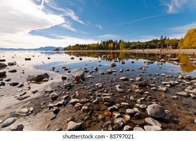 Lake Tahoe in fall with reflections of trees and the sky