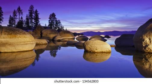 Lake Tahoe Sunset with granite boulders.