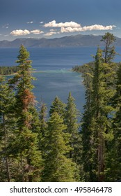 Lake Tahoe through trees with mountains in background