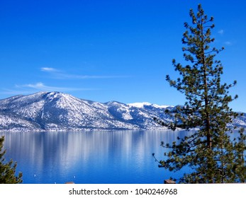 Lake Tahoe in winter on sunny day reflecting mountains