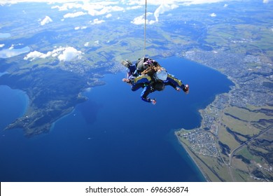 LAKE TAUPO, NEW ZEALAND - AUGUST 9, 2017 - Tandem free fall sky diving with 15,000 feet at Lake Taupo, New Zealand.