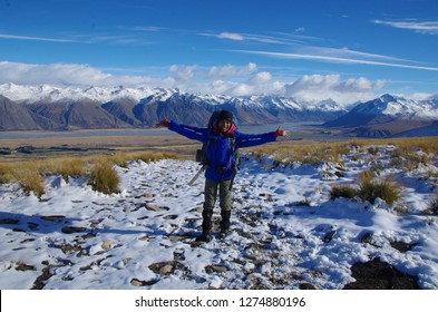 Lake Tekapo, Canterbury, New Zealand. April 29, 2015. Thai backpacker at Lake tekapo mountains in the snow