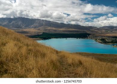 Lake Tekapo and mountains, dramatic cloudy sky, South Island New Zealand