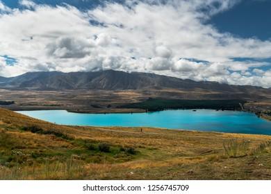 Lake Tekapo, mountains, dramatic cloudy sky, South Island New Zealand