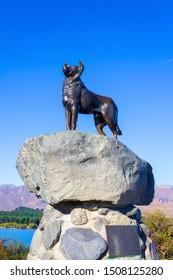 Lake Tekapo, New Zealand - March 29, 2019: Editorial Photo of Bronze Sheepdog Statue at Lake Tekapo, South Island in a beautiful day with blue sky