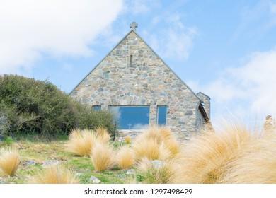 LAKE TEKAPO NEW ZEALAND - OCTOBER 14; tourists viewing and  taking photos around iconic  Church of Good Shepherd October 14 2018 Lake Tekapo, New Zealand