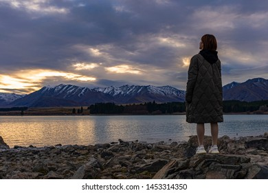 LAKE TEKAPO, NZ - JULY 13: Visitors at the church of the good shepherd at Lake Tekapo on July 13, 2019. It is the most famous and photographed church in New Zealand.