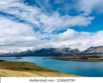 Lake Tekapo with its turquoise water viewed from the summit of Mount John