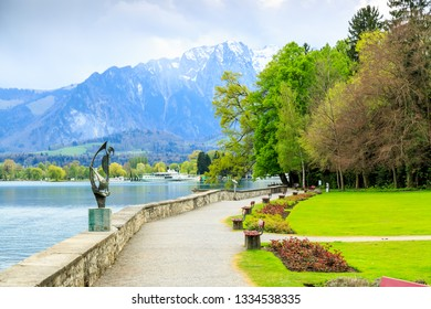 Lake Thun nice shore and alps mountains in the city of Thun, Switzerland