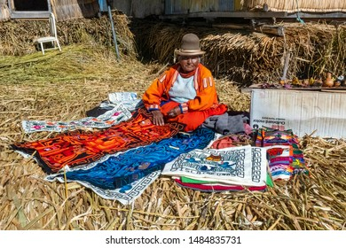 Lake Titicaca, Peru - August 2, 2019: Uros Tribe demonstrating life on the floating island at Lake Titicaca