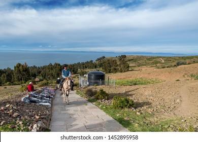 LAKE TITICACA, PERU - FEB 4: Scene on Isla Amantani of a male local on a horse on February 4, 2017.