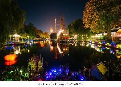 The lake at Tivoli Gardens at night, in Copenhagen, Denmark.