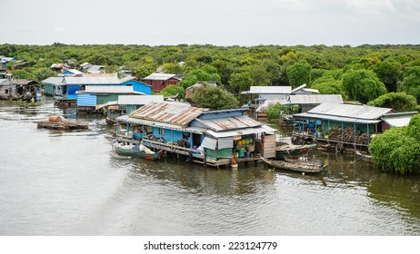 LAKE TONLE SAP, COMBODIA - SEP 28, 2014: View of a Floating village Chong Knies on the Tonle Sap. Lake Tonle Sap is the largest freshwater lake in Southeast Asia, a UNESCO biosphere since 1997