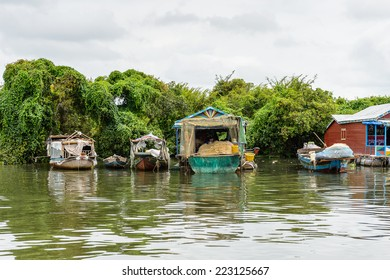 LAKE TONLE SAP, COMBODIA - SEP 28, 2014: Boats and houses of the Chong Knies Village on the Tonle Sap Lake, the largest freshwater lake in Southeast Asia, a UNESCO biosphere since 1997